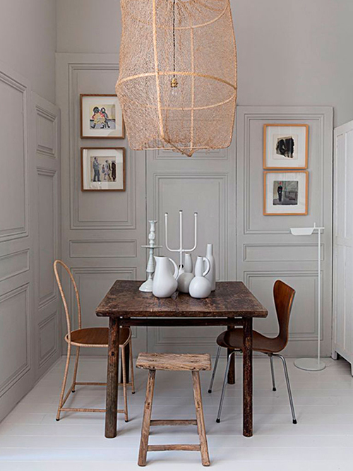 This dining room has drama in spades, with a statement light and contrast between the new and vintage chairs. Image via Pierre Emmanuel Martin.