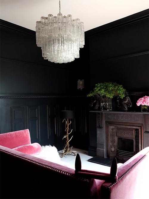 UK interiors expert Michael Minns teams dark walls with a striking pink sofa in his Edwardian villa.
