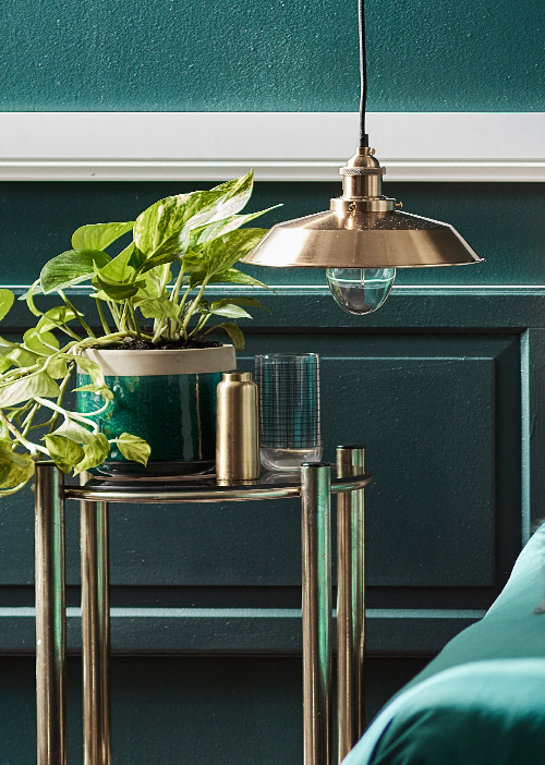 Brass is the on-trend metallic that works best with teal.