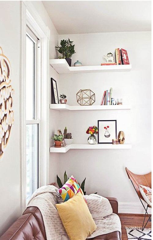 Wall shelves offer a place for storage and styling without taking up valuable floorspace. Image via apartmentherapy.com.
