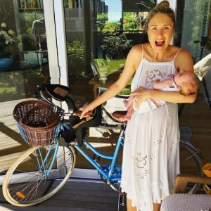 Magdalena last Christmas with her favourite gifts - a blue bike and beautiful baby Archie! Pic via Instagram @magdalena_roze