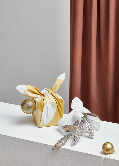 Fabric wrapping is a perfect alternative to paper.